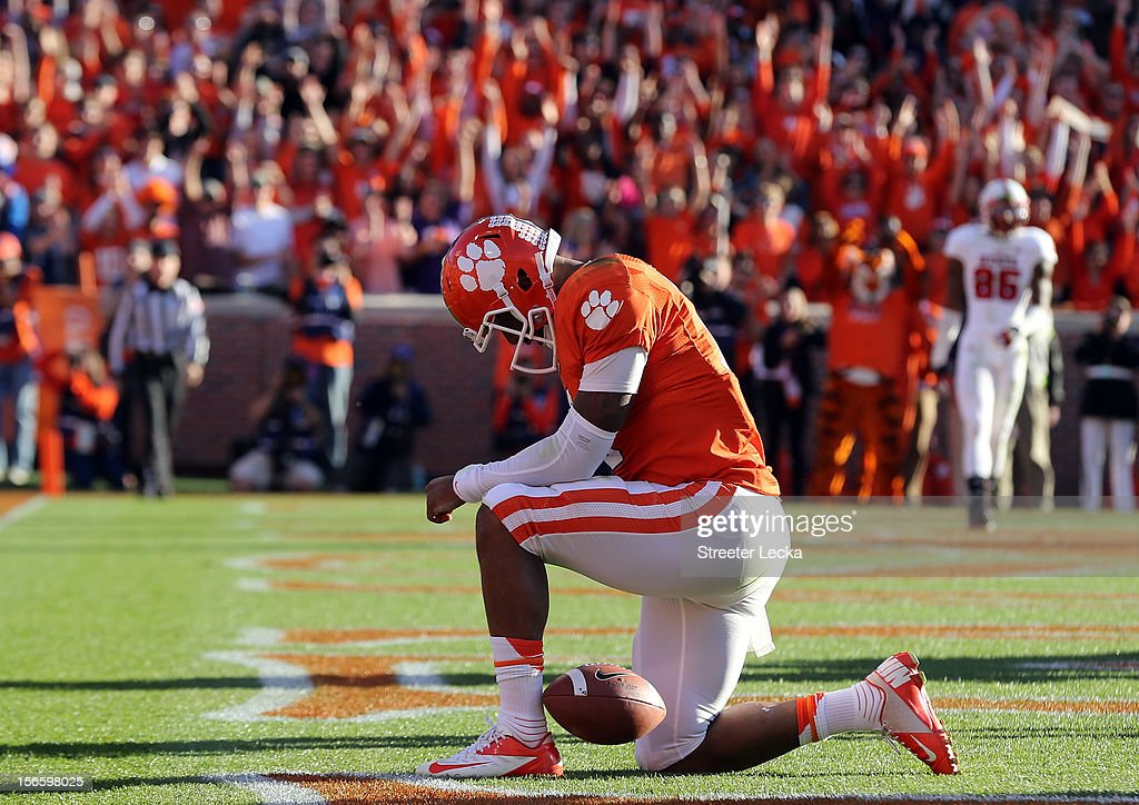 <a gi-track='captionPersonalityLinkClicked' href=/galleries/search?phrase=Tajh+Boyd&family=editorial&specificpeople=7352415 ng-click='$event.stopPropagation()'>Tajh Boyd</a> #10 of the Clemson Tigers reacts to scoring a touchdown against the North Carolina State Wolfpack during their game at Memorial Stadium on November 17, 2012 in Clemson, South Carolina.