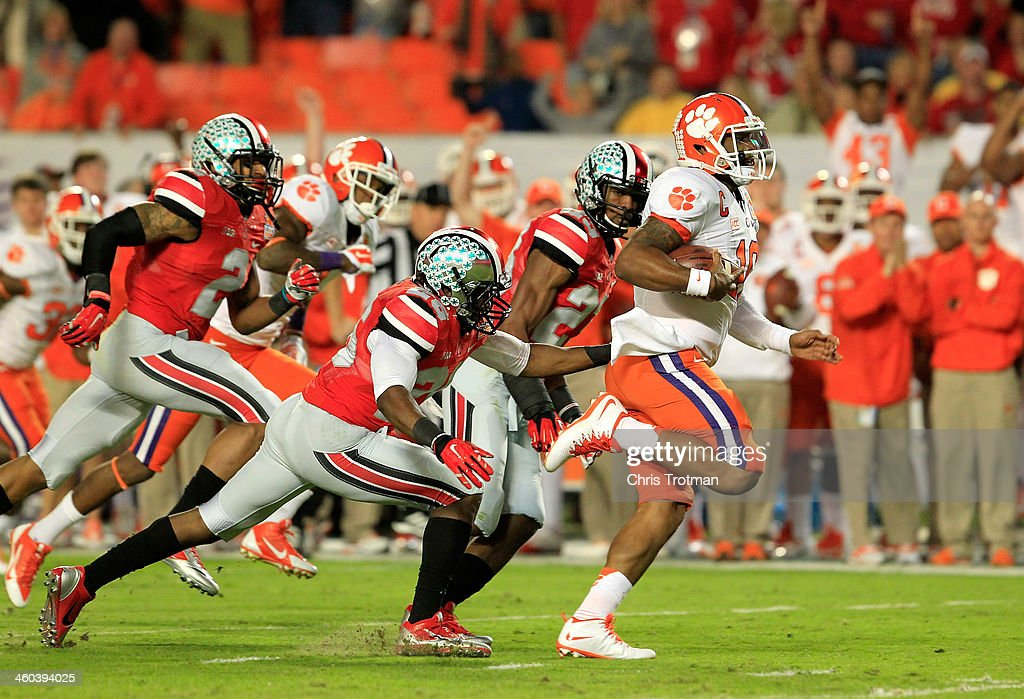 <a gi-track='captionPersonalityLinkClicked' href=/galleries/search?phrase=Tajh+Boyd&family=editorial&specificpeople=7352415 ng-click='$event.stopPropagation()'>Tajh Boyd</a> #10 of the Clemson Tigers runs for a touchdown in the first half against the Ohio State Buckeyes during the Discover Orange Bowl at Sun Life Stadium on January 3, 2014 in Miami Gardens, Florida.