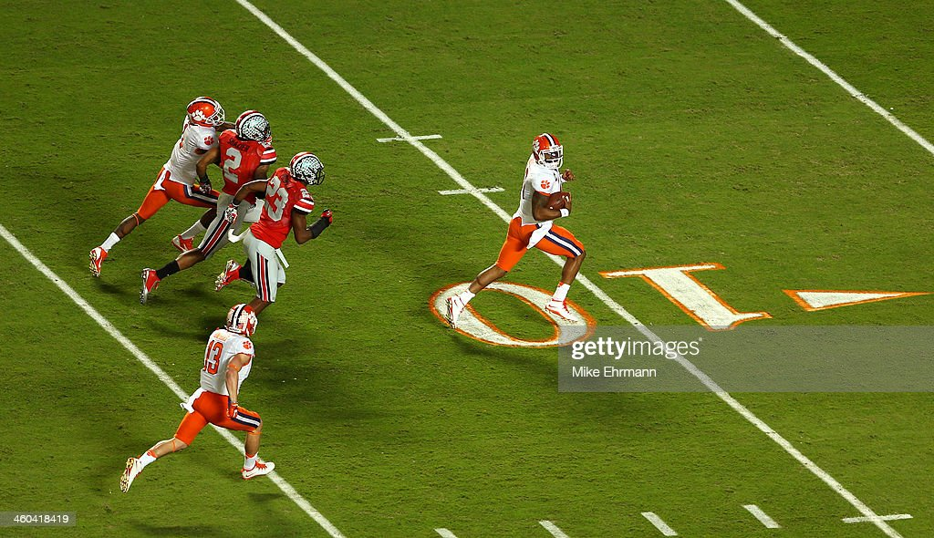 <a gi-track='captionPersonalityLinkClicked' href=/galleries/search?phrase=Tajh+Boyd&family=editorial&specificpeople=7352415 ng-click='$event.stopPropagation()'>Tajh Boyd</a> #10 of the Clemson Tigers runs for a touchdown in the first quarter against the Ohio State Buckeyes during the Discover Orange Bowl at Sun Life Stadium on January 3, 2014 in Miami Gardens, Florida.