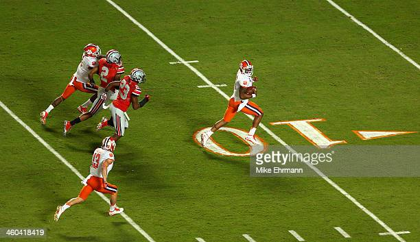 Tajh Boyd of the Clemson Tigers runs for a touchdown in the first quarter against the Ohio State Buckeyes during the Discover Orange Bowl at Sun Life...