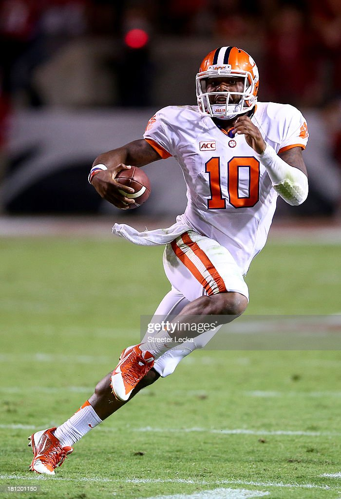 <a gi-track='captionPersonalityLinkClicked' href=/galleries/search?phrase=Tajh+Boyd&family=editorial&specificpeople=7352415 ng-click='$event.stopPropagation()'>Tajh Boyd</a> #10 of the Clemson Tigers runs with the ball against the North Carolina State Wolfpack during their game at Carter-Finley Stadium on September 19, 2013 in Raleigh, North Carolina.