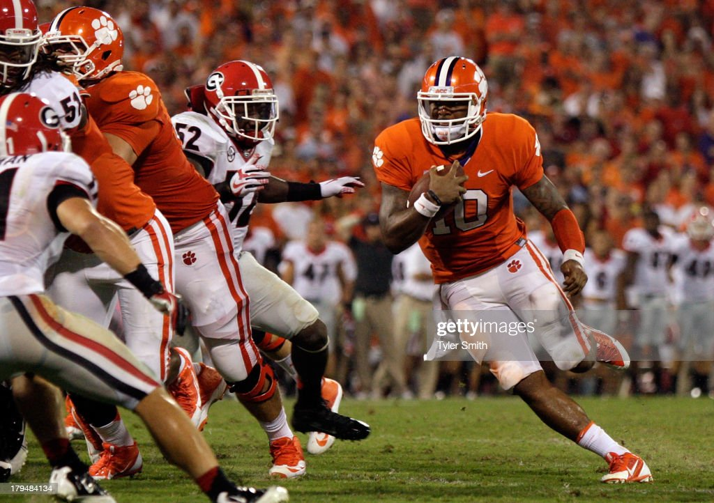 <a gi-track='captionPersonalityLinkClicked' href=/galleries/search?phrase=Tajh+Boyd&family=editorial&specificpeople=7352415 ng-click='$event.stopPropagation()'>Tajh Boyd</a> #10 of the Clemson Tigers rushes for a touchdown during the game against the Georgia Bulldogs at Memorial Stadium on August 31, 2013 in Clemson, South Carolina.