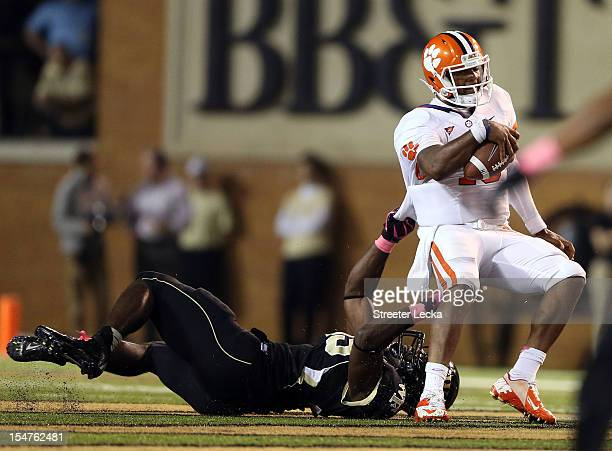 Tajh Boyd of the Clemson Tigers tries to get away from a Wake Forest Demon Deacons defender during their game at BBT Field on October 25 2012 in...