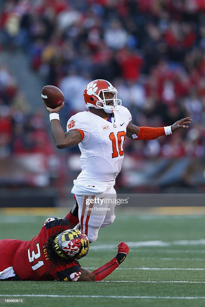 <a gi-track='captionPersonalityLinkClicked' href=/galleries/search?phrase=Tajh+Boyd&family=editorial&specificpeople=7352415 ng-click='$event.stopPropagation()'>Tajh Boyd</a> #10 of the Clemson Tigers tries to throw a pass while being pressured by Shawn Petty #31 of the Maryland Terrapins during the first half of the game at Byrd Stadium on October 26, 2013 in College Park, Maryland.