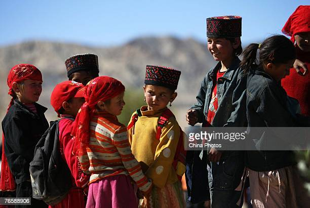 Tajik students go back home from school after a day's study on September 7 2007 in Tashikuergan County of Xinjiang Uygur Autonomous Region China...