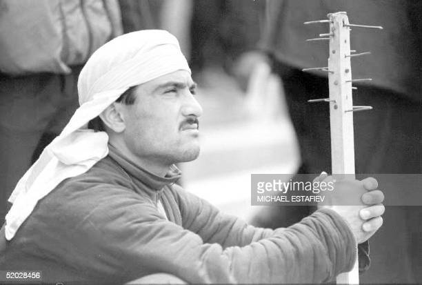 Tajikistan An opposition supporter holds his selfmade weapon as he listens to leaders of different Islamic parties in Shakhedon Square 07 May After...