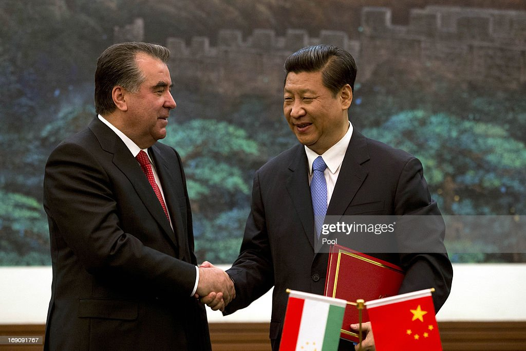 Tajikistan President Emomali Rahmon and Chinese President <a gi-track='captionPersonalityLinkClicked' href=/galleries/search?phrase=Xi+Jinping&family=editorial&specificpeople=2598986 ng-click='$event.stopPropagation()'>Xi Jinping</a> shake hands after a signing ceremony at the Great Hall of the People on May 20, 2013 in Beijing, China. Rahmon is in China for the first time on a two-day visit to discuss bilateral talks between countries.