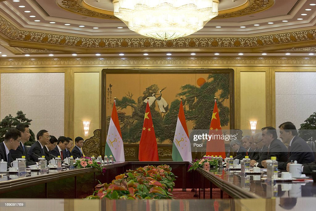 Tajikistan President Emomali Rahmon (2nd R) and Chinese President <a gi-track='captionPersonalityLinkClicked' href=/galleries/search?phrase=Xi+Jinping&family=editorial&specificpeople=2598986 ng-click='$event.stopPropagation()'>Xi Jinping</a> (3rd L) talk during their meeting at the Great Hall of the People on May 20, 2013 in Beijing, China. Rahmon is in China for the first time on a two-day visit to discuss bilateral talks between countries.