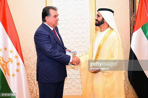 Tajikistan's President Emomali Rahmon and Vice President of United Arab Emirates Mohammed bin Rashid Al Maktoum shake hands after their...