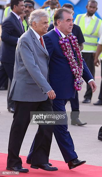 Tajikistan's President Emomali Rahmon walk near Sri Lankan Prime Minister Ranil Wickremesinghe during a welcoming ceremony upon his arrival at the...