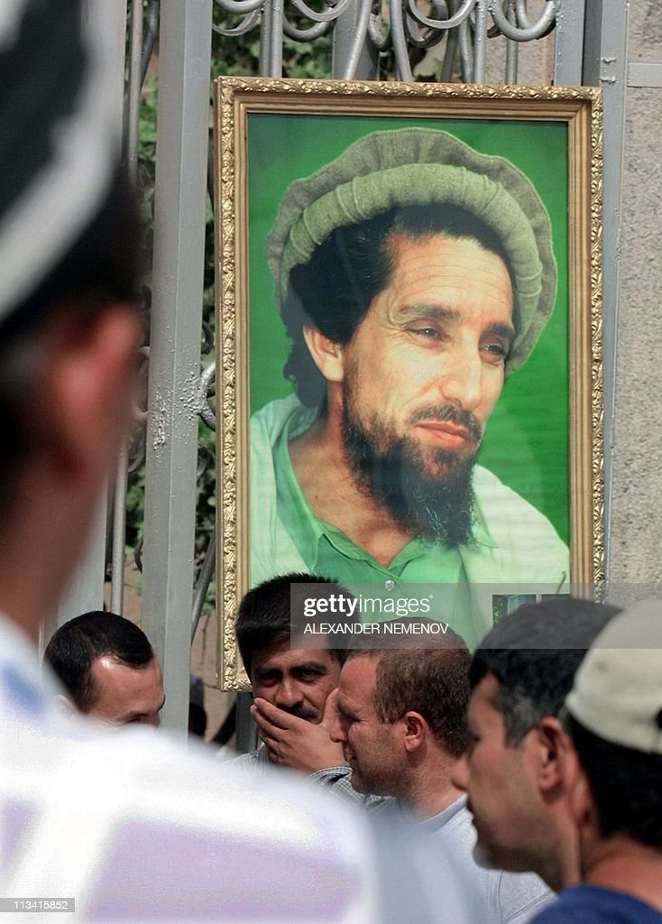 Tajiks and Afghans wait 18 September 2001 for the start of the prayer for Afghan opposition commander Ahmad Shah Masood outside a mosque in Dushanbe...