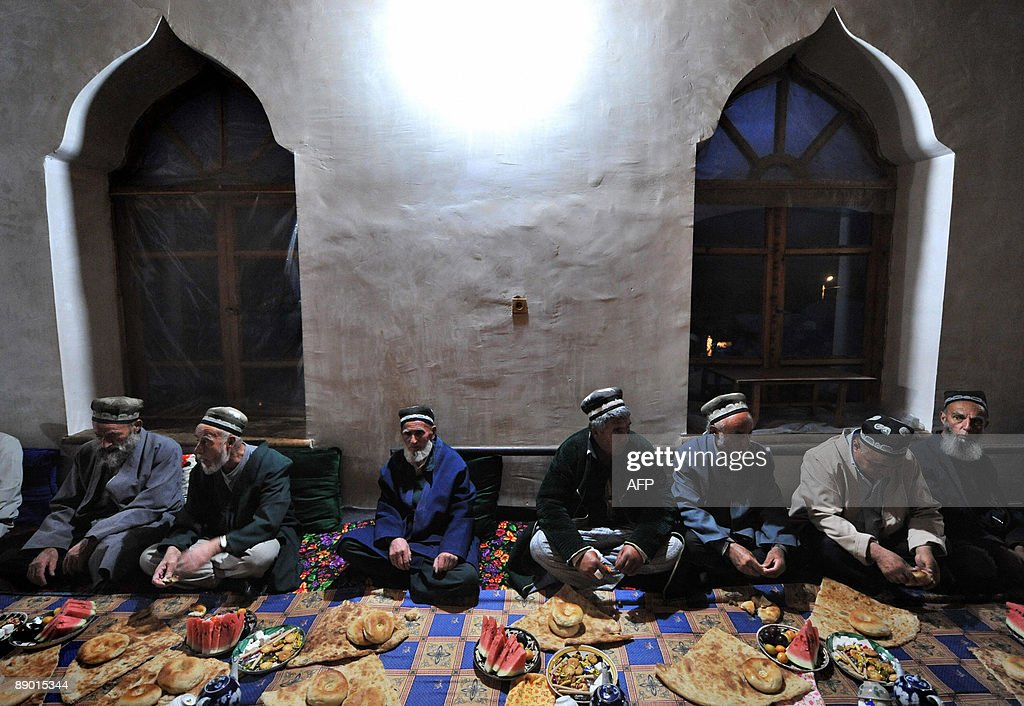 SIEGEL Tajiks have a lunch after praying in village Garm on July 12 2009 A secretive military operation has raised fears that Islamist fighters...