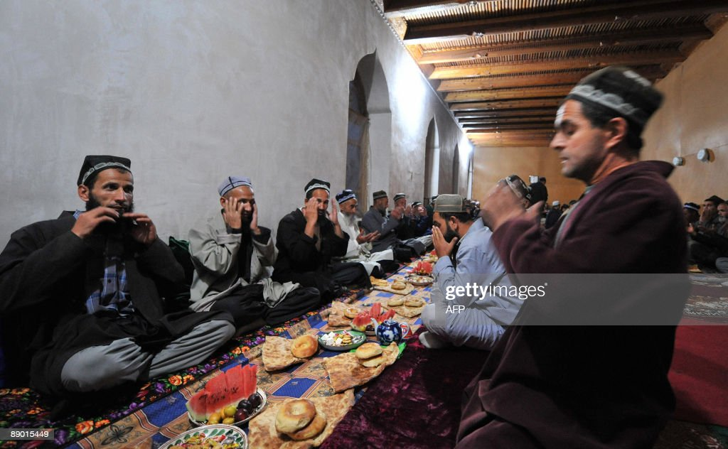 SIEGEL Tajiks pray before the evening meal in the village of Garm some 250km from Dushanbe on July 12 2009 A secretive military operation has raised...