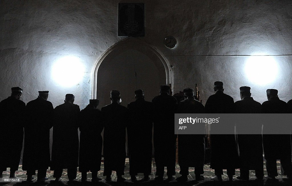 SIEGEL Tajiks pray in the village of Garm some 250km from Dushanbe on July 12 2009 A secretive military operation has raised fears that Islamist...