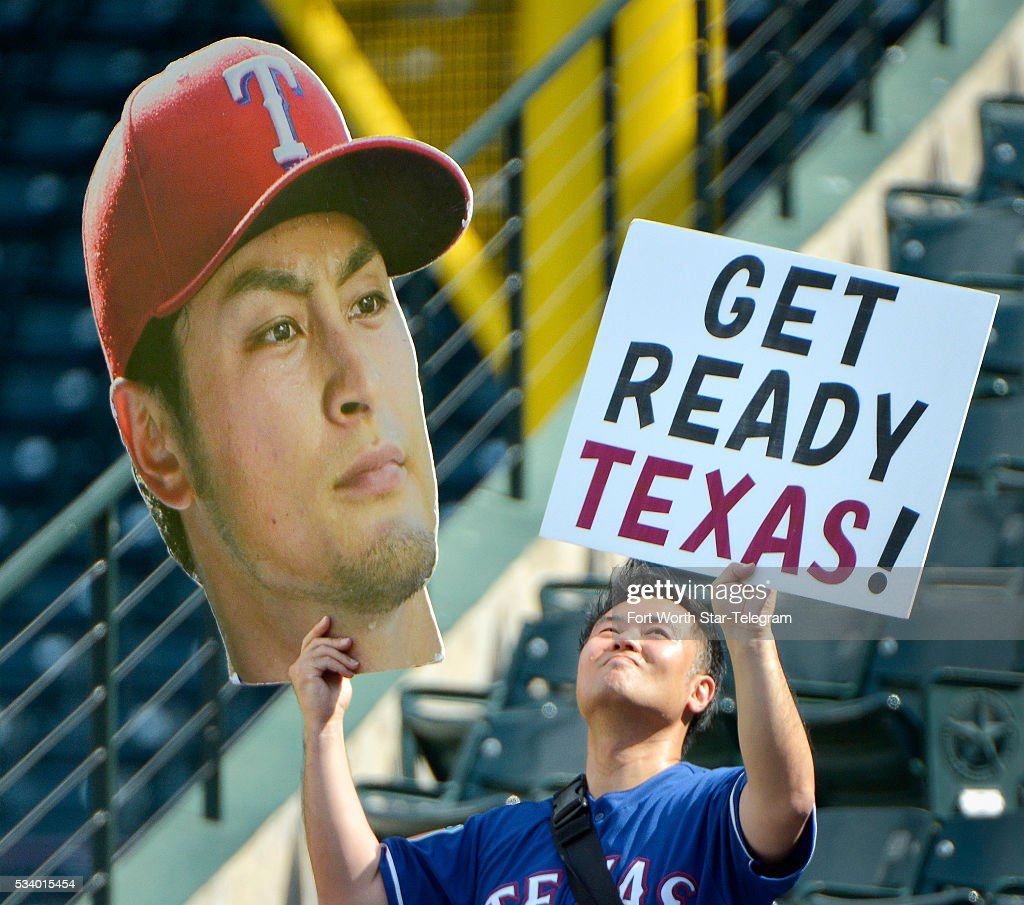 Tak Fujita of Irving, Texas, is excited about the impending return of Texas Rangers starting pitcher Yu Darvish as the Los Angeles Angels visit Globe Life Park in Arlington, Texas, on Tuesday, May 24, 2016. Darvish, coming off Tommy John surgery, is expected to make his season debut on Saturday against the Pittsburgh Pirates.