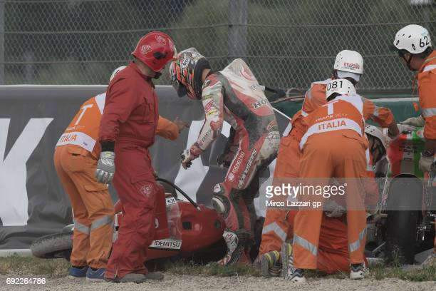 Takaaki Nakagami of Japan and Idemitsu Honda Team Asia crashed out during the Moto2 race during the MotoGp of Italy Race at Mugello Circuit on June 4...