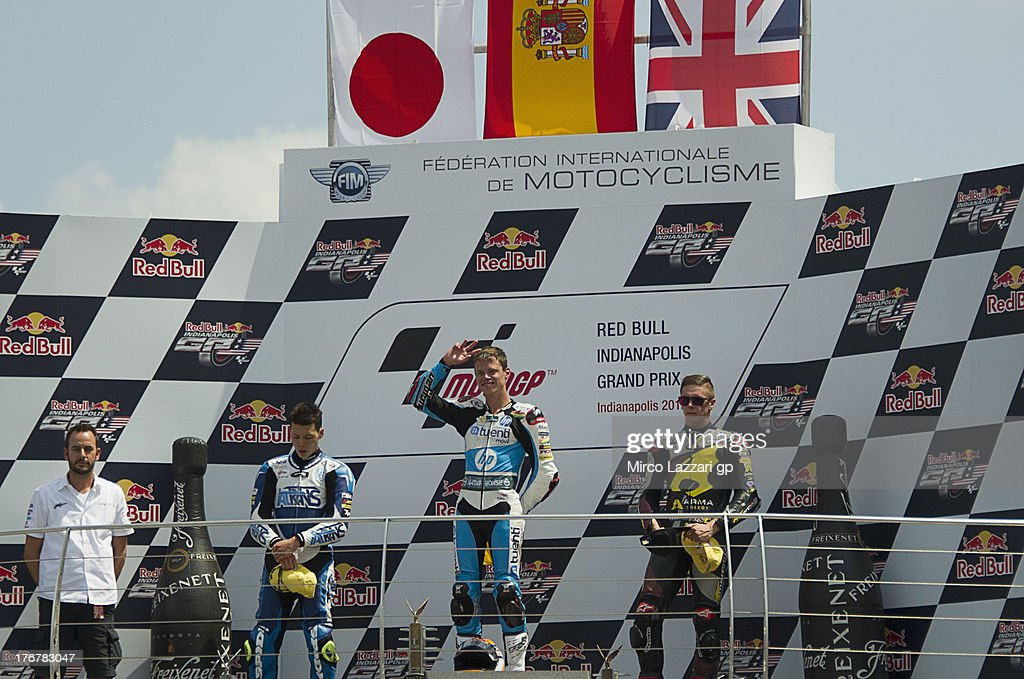 Takaaki Nakagami of Japan and Italtrans Racing Team, Esteve Rabat of Spain and Pons 40 HP Tuenti and Scott Redding of Great Britain and Marc VDS Racing Team pose on the podium at the end of the Moto2 race and celebrates the victory during the MotoGp Red Bull U.S. Indianapolis Grand Prix - Race at Indianapolis Motor Speedway on August 18, 2013 in Indianapolis, Indiana.
