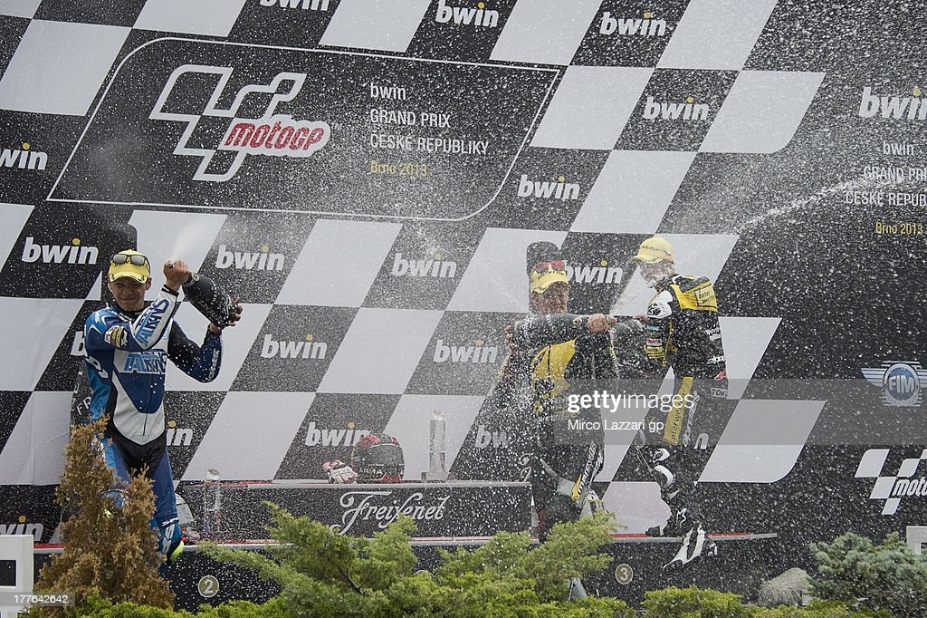 Takaaki Nakagami of Japan and Italtrans Racing Team, Mika Kallio of Finland and Marc VDS Racing Team Thomas Luthi of Switzerland and Interwetten Paddock celebrates on the podium at the end of the Moto2 race during the MotoGp of Czech Republic - Race at Brno Circuit on August 25, 2013 in Brno, Czech Republic.