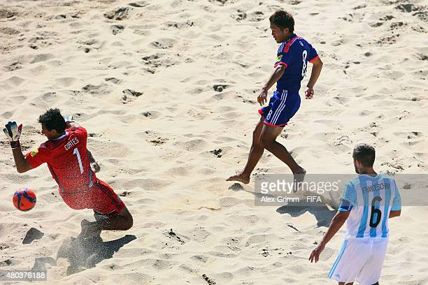 Takaaki Oba of Japan scores his team's fourth goal against goalkeeper Dardo Cortes and Luciano Franceschini of Argentina during the FIFA Beach Soccer...