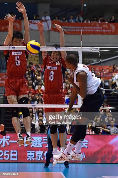 Takaaki Tomimatsu and Masahiro Yanagida of Japan block the ball during the Men's World Olympic Qualification game between Japan and Venezuela at...