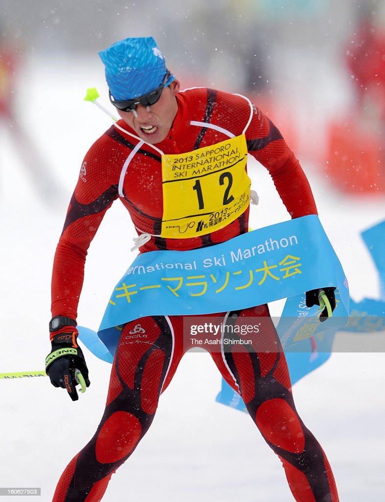 Takafumi Miyoshi crosses the finishing tape to win in the Men's 25km of the Sapporo International Ski Marathon 2013 on February 3, 2013 in Sapporo, Hokkaido, Japan.