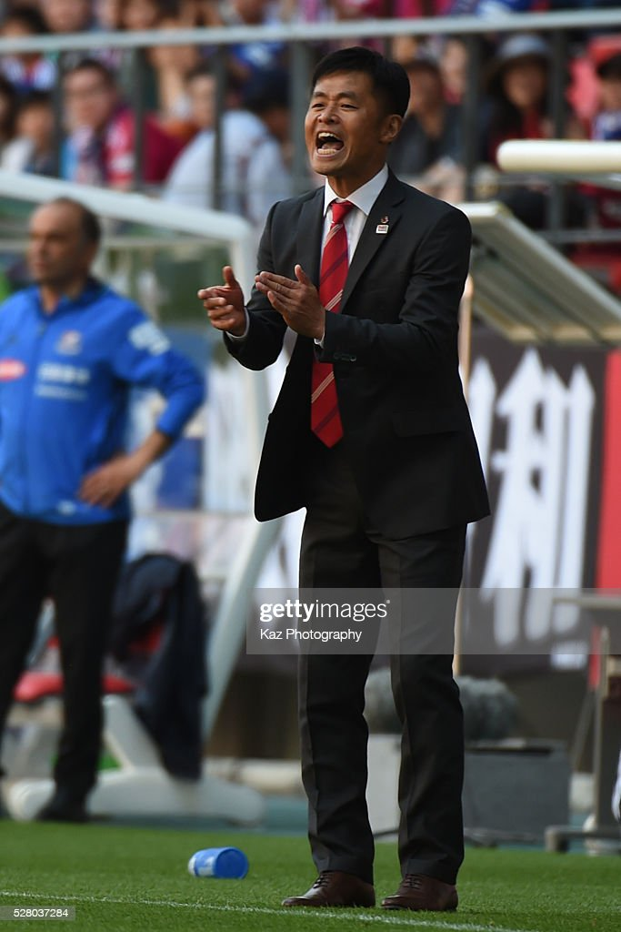 Takafumi Ogura, manager of Nagoya Grampus celebrates the 3rd goal during the J.League match between Nagoya Grampus and Yokohama F.Marinos at the Toyota Stadium on May 4, 2016 in Toyota, Aichi, Japan.