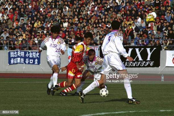 Takafumi Ogura of Nagoya Grampus Eight controls the ball under pressure of Kyoto Purple Sanga defense during the 75th Emperor's Cup first round...