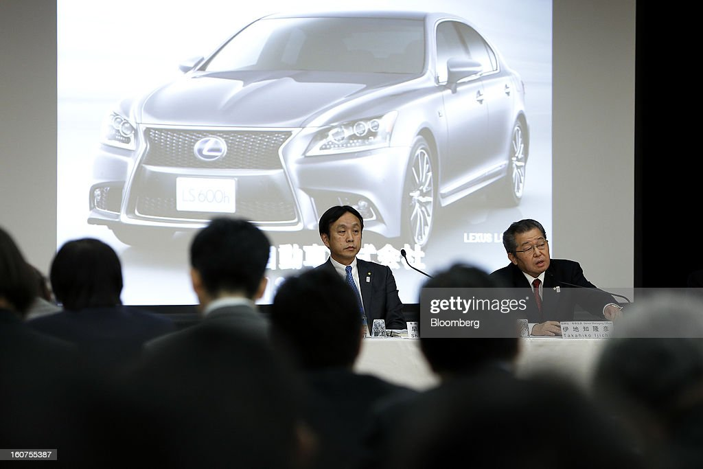 Takahiko Ijichi, senior managing officer at Toyota Motor Corp., right, speaks as Shigeru Hayakawa, senior managing officer, listens during a news conference in Tokyo, Japan, on Tuesday, Feb. 5, 2013. Toyota, the world's biggest carmaker, raised its profit forecast after the yen weakened more than any other currency, raising the value of Japanese cars sold overseas. Photographer: Kiyoshi Ota/Bloomberg via Getty Images