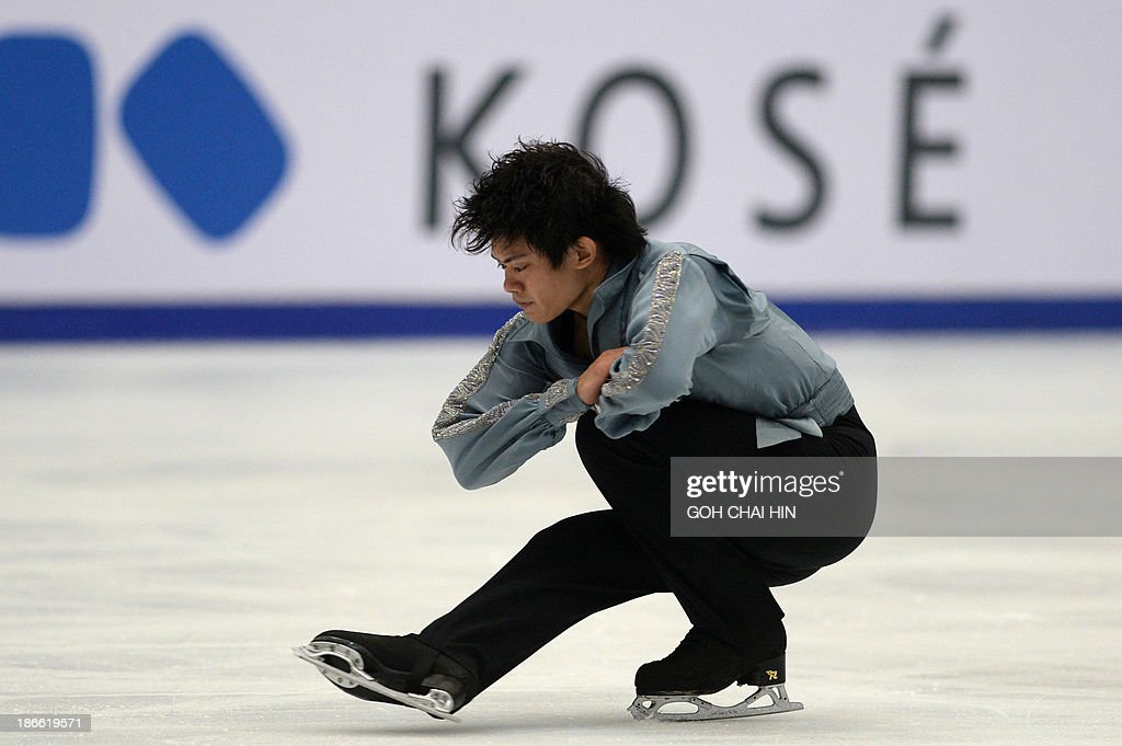 Takahiko Kozuka of Japan performs during the men free skating event of the Cup of China ISU Grand Prix of Figure Skating in Beijing on November 2, 2013. Kozuka won third place with a total score of 226.92.