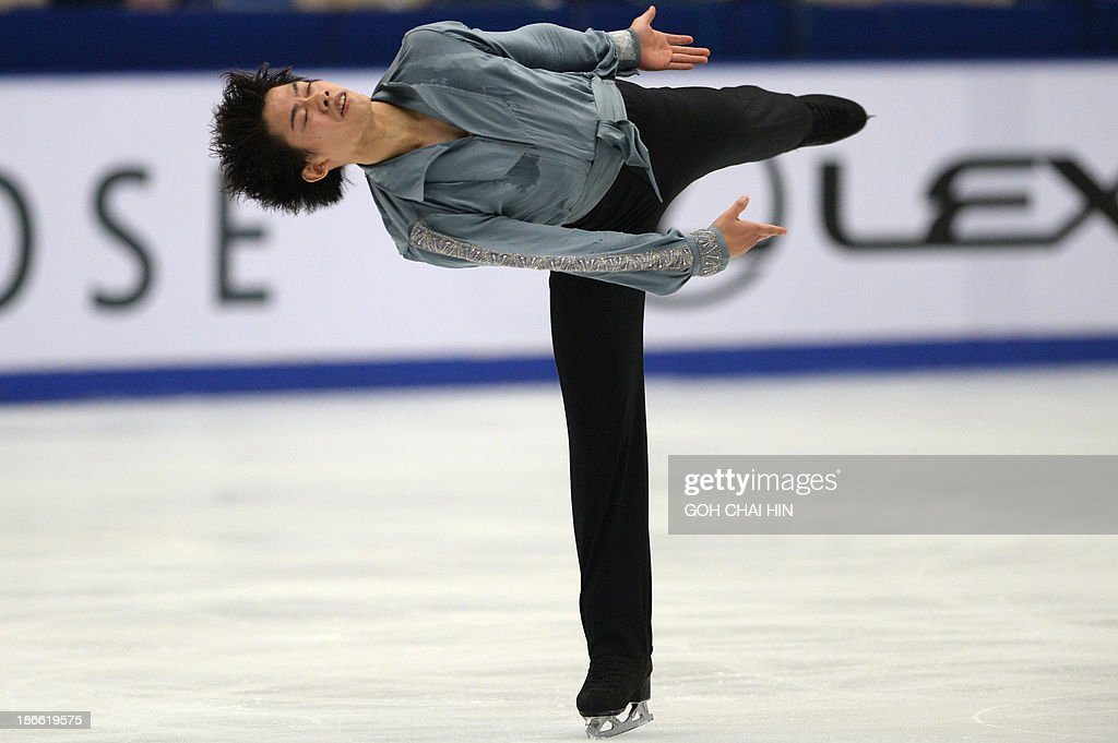Takahiko Kozuka of Japan performs during the men free skating event of the Cup of China ISU Grand Prix of Figure Skating in Beijing on November 2, 2013. Kozuka won third place with a total score of 226.92. AFP PHOTO / GOH CHAI HIN