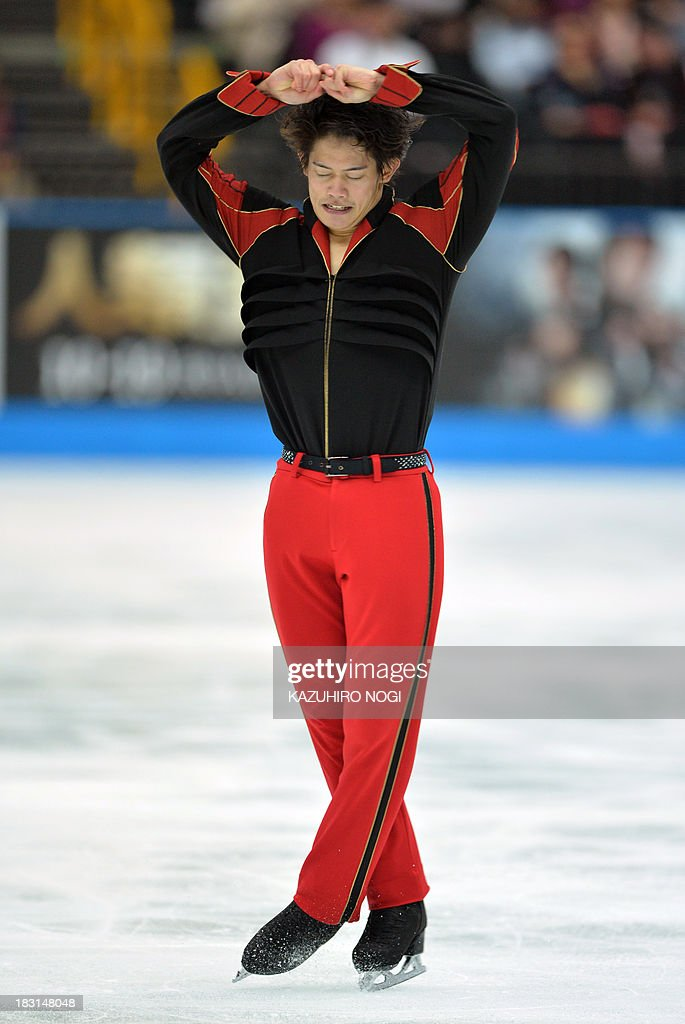 Takahiko Kozuka of Japan performs in the men's free skating at the Japan Open figure skating competition at Saitama Super Arena in Saitama on October 5, 2013. Kozuka scored with a 158.42 points and his team Japan won the competition with a total 544.85 points.