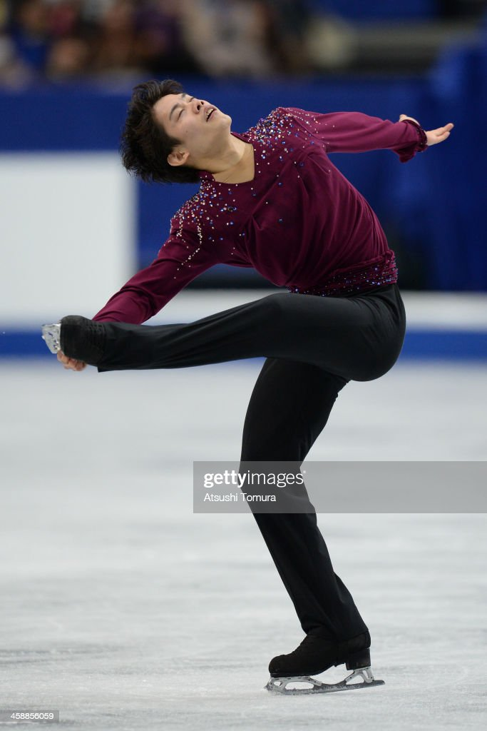 <a gi-track='captionPersonalityLinkClicked' href=/galleries/search?phrase=Takahiko+Kozuka&family=editorial&specificpeople=686867 ng-click='$event.stopPropagation()'>Takahiko Kozuka</a> of Japan performs in the men's free skating during All Japan Figure Skating Championships at Saitama Super Arena on December 22, 2013 in Saitama, Japan.