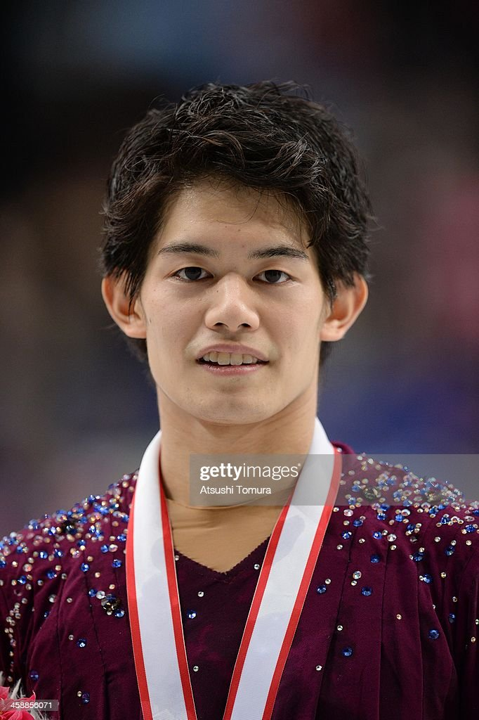 <a gi-track='captionPersonalityLinkClicked' href=/galleries/search?phrase=Takahiko+Kozuka&family=editorial&specificpeople=686867 ng-click='$event.stopPropagation()'>Takahiko Kozuka</a> of Japan poses with medal in the men's single victory ceremony during All Japan Figure Skating Championships at Saitama Super Arena on December 22, 2013 in Saitama, Japan.