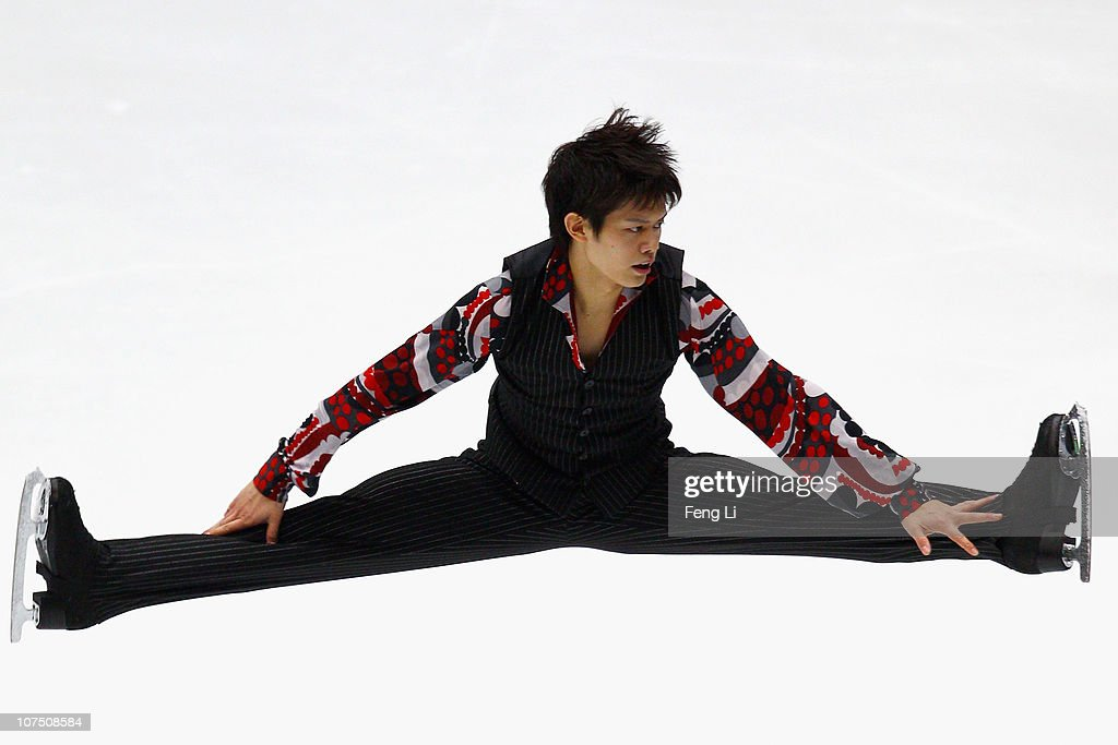 <a gi-track='captionPersonalityLinkClicked' href=/galleries/search?phrase=Takahiko+Kozuka&family=editorial&specificpeople=686867 ng-click='$event.stopPropagation()'>Takahiko Kozuka</a> of Japan skates in the Men Short Program during ISU Grand Prix and Junior Grand Prix Final at Beijing Capital Gymnasium on December 10, 2010 in Beijing, China.