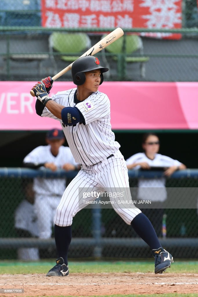 Takahiro Kumagai #4 of Japan bats against Mexico during the Baseball Group B match between Japan and Mexico during the Universiade Taipei at the Xinzhuang Baseball Stadium on August 22, 2017 in Taipei, Taiwan.