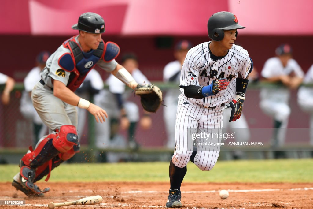 Takahiro Kumagai #4 of Japan bunts for a base hit in the fifth inning during the Baseball Group B match between Japan and United States during the Universiade Taipei at Xinzhuang Baseball Stadium on August 23, 2017 in Taipei, Taiwan.