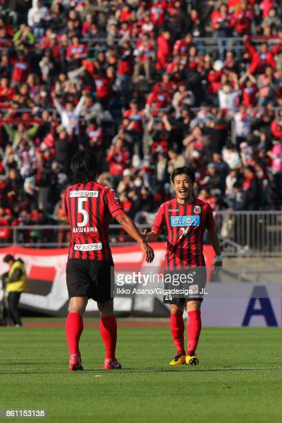 Takahiro Masukawa and Ryota Hayasaka of Consadole Sapporo celebrate their 30 victory in the JLeague J1 match between Consadole Sapporo and Kashiwa...