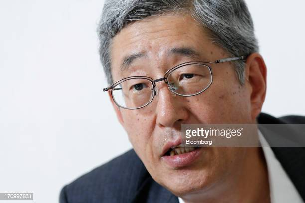 Takahiro Mitani president of the Government Pension Investment Fund speaks during an interview in Tokyo Japan on Friday June 21 2013 Japan's...
