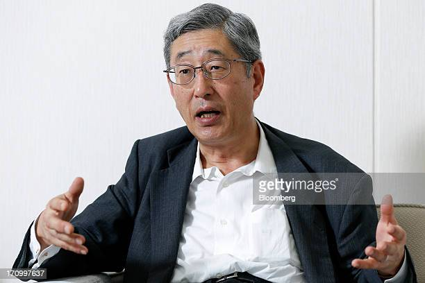 Takahiro Mitani president of the Government Pension Investment Fund gestures as he speaks during an interview in Tokyo Japan on Friday June 21 2013...