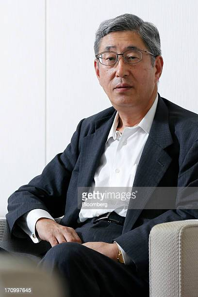 Takahiro Mitani president of the Government Pension Investment Fund poses for a photograph in Tokyo Japan on Friday June 21 2013 Japan's Government...