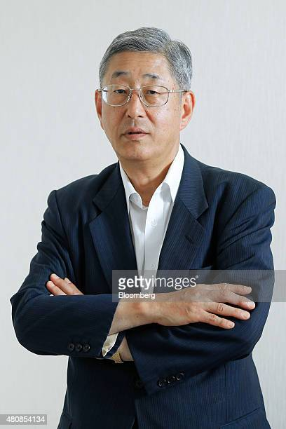 Takahiro Mitani president of the Government Pension Investment Fund poses for a photograph in Tokyo Japan on Tuesday July 14 2015 The world's biggest...