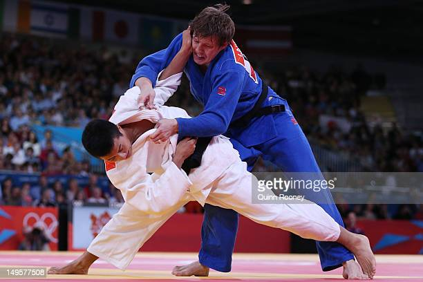 Takahiro Nakai of Japan competes with Ivan Nifontov of Russia in the Men's 81 kg Judo on Day 4 of the London 2012 Olympic Games at ExCeL on July 31...