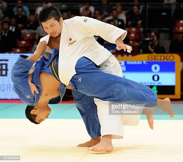 Takahiro Nakai of Japan tries to throw his compatriot Masahiro Takamatsu during their men's 81kg class final match in the Judo Grand Slam Tokyo judo...