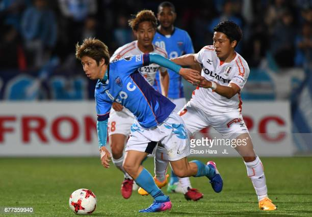 Takahiro Nakazato of Yokohama FC controls the ball under pressure of Koki Arita of Ehime FC during the JLeague J2 match between Yokohama FC and Ehime...