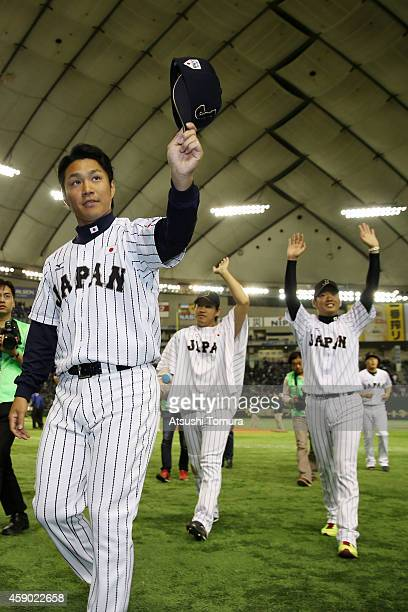 Takahiro Norimoto Kazuhisa Makita and Yuki Nishi of Samurai Japan wave for fans after winning the game three of Samurai Japan and MLB All Stars at...