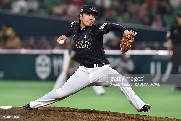 Takahiro Norimoto of Japan pitches in the bottom half of the 7th inning during the sendoff friendly match for WBSC Premier 12 between Japan and...