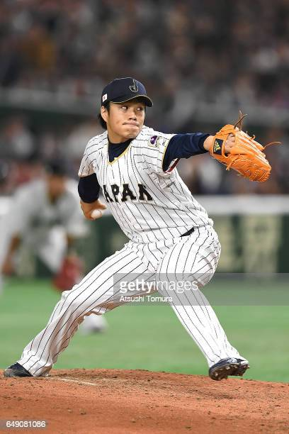 Takahiro Norimoto of Japan pitches in the fifth inning of the World Baseball Classic Pool B Game One between Cuba and Japan at Tokyo Dome on March 7...