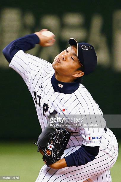 Takahiro Norimoto of Samurai Japan pitches during the game three of Samurai Japan and MLB All Stars at Tokyo Dome on November 15 2014 in Tokyo Japan
