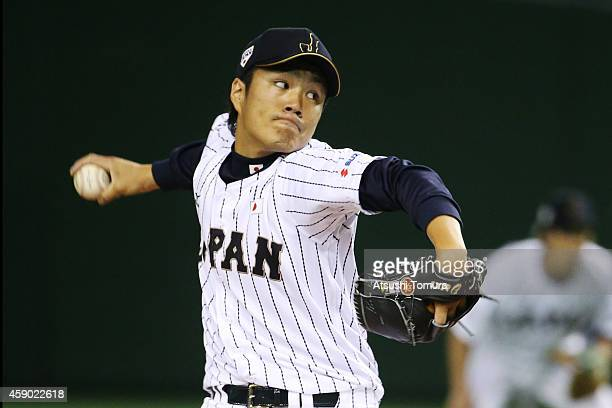 Takahiro Norimoto of Samurai Japan pitches in the first inning during the game three of Samurai Japan and MLB All Stars at Tokyo Dome on November 15...