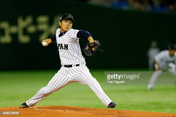 Takahiro Norimoto of the Samurai Japan pitches in the first inning during the game against the MLB AllStars at the Tokyo Dome during the Japan...